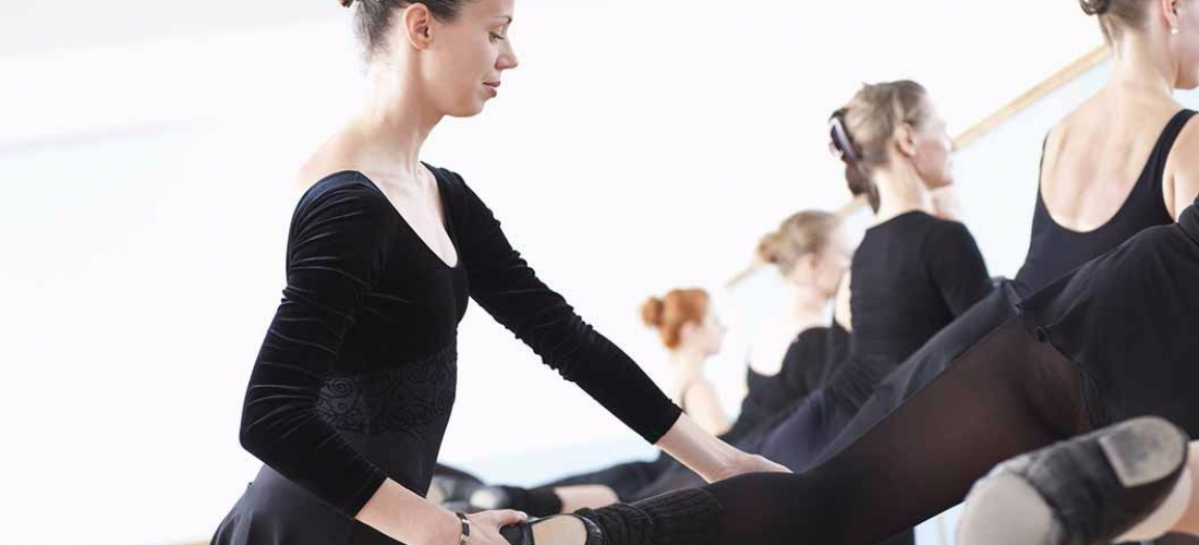 Ballet instructor working with young student